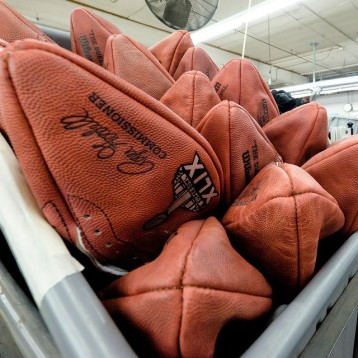 Super Bowl game balls waiting to be laced and inflated