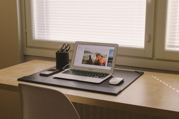 uncluttered desk with macbook computer